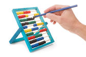 Office tool abacus for accounts. Hand with pencil dials. — Stock Photo