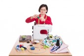 Woman seamstress at the sewing machine. Sewing Accessories. — Foto Stock