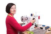 Woman seamstress at the sewing machine. Sews clothes. — Stock Photo