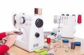 Woman seamstress work on the sewing products. On a white background. — Stock Photo