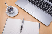 Laptop computer at work. With a cup of coffee. — Stock Photo