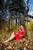 Girl fall  park leaves trees,book, apple — Stock Photo