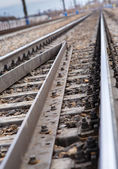 Rails, cross ties, columns, wires — Stok fotoğraf
