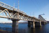 Railroad bridge winter river — Stock Photo