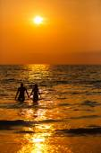 loving couple  at sunset in the sea — Stock Photo
