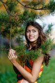 Happy young woman in the autumn wood of the mountain — Stock Photo