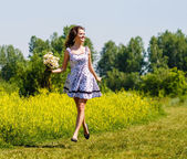 Young sexy girl with flowers in the field — Stok fotoğraf