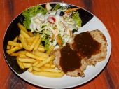 Fried potato, pork, salad on  plate — Stock Photo