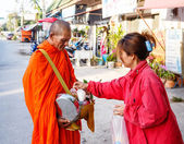 The reporting from the street, ritual of a gift of food for monk — Stock Photo