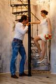 Man and the woman - the groom and the bride in the room a screw  — Стоковое фото