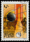 Stamp printed in Hungary shows Sputnik I  — Stok fotoğraf