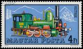 Stamp printed in Hungary shows austrian locomotive — 图库照片