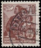 Stamp printed in GDR, shows a family — Photo
