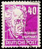 Stamp printed in Germany shows portrait of Gerhart Hauptmann — Stock Photo