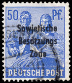 Stamp printed in Germany shows Reaping Wheat — Stock Photo