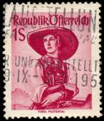 Stamp printed in Austria, shows a woman in national dress, Tirol — Stock Photo