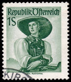 Stamp printed in Austria, shows a woman from Tirol, Pusterta — Stock Photo