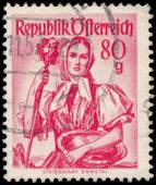 Stamp printed in Austria, shows a woman from Steiermark, Ennstal — Stockfoto