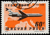 Stamp printed in Hungary shows plane TU-154 — ストック写真