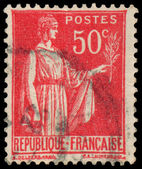 Stamp printed in France shows a woman with Olive Branch — Stok fotoğraf
