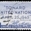 Постер, плакат: Stamp printed in USA commemorating the creation of the United Na