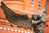 Statue Of Archangel Michael With Outstretched Wings Before Catho — Stock Photo