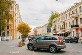 Car parking on sidewalk on Karl Marx Street in autumn — Stock Photo