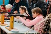 Unrecognizable Belarusian secondary school pupils girls shooting — Stock Photo