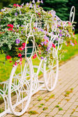 White Decorative Bicycle Parking In Garden  — Stock Photo