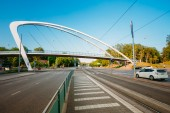 Modern pedestrian bridge over street — Stock Photo