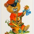Reproduction of antique postcard shows bear dressed in tradition — Stock Photo #61340217