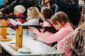 Unrecognizable Belarusian secondary school pupils girl shooting — Stock Photo