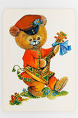 Reproduction of antique postcard shows bear dressed in tradition — Stock Photo