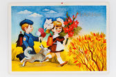 Reproduction of antique postcard shows Soviet children - a boy a — Stock Photo
