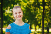 Closeup Portrait Of Girl In Blue Knitted Dress — Stock Photo