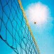 Volleyball Ball Over Net On Background Of Blue Summer Sunny Sky — Stock Photo #62764315