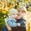Young Woman Mother Hugging Her Baby Son — Stock Photo #64745389