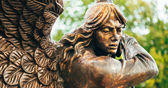 Statue Of Archangel Michael With Outstretched Wings Before Red C — Stock Photo