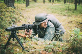 Unidentified re-enactor dressed as German soldier machine-gunner — Stock Photo