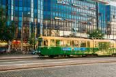 Tram departs from a stop on street Aleksanterinkatu in Helsinki — Stock Photo