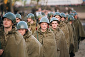Parade of unidentified re-enactors dressed as Soviet soldiers du — Stock Photo