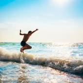 Boy Jumping In Sea Waves — Stock Photo