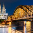 Night View Of Cologne Cathedral And Hohenzollern Bridge, Germany — Stock Photo #80698388