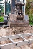Small excavator — Stock Photo