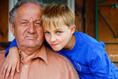 Grandfather and his beloved ones boys — Stock Photo
