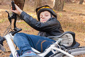 Boy and bicycle — Stock Photo
