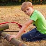Boy ang garden — Stock Photo #55539255