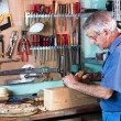 Carpenter working with wood — Stock Photo #57203455