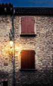 Streetlights and closed windows at the eveing in france village — Stock Photo