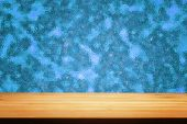 A table with blue blur frosted glass as background — ストック写真